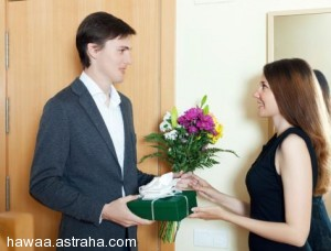 Happy man with flowers and gift box